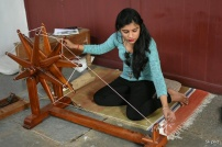Spinning cotton on a Charkha